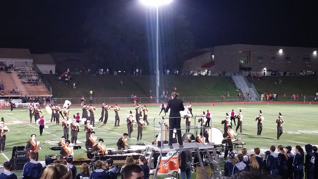 The Cherokee marching band under the Friday night lights