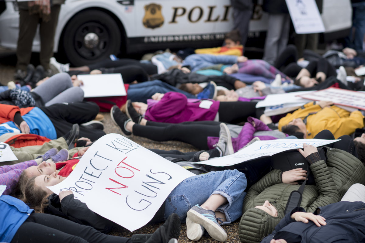 Washington, D.C., area students and supporters protest against gun violence with a lie-in outside of the White House on Monday, Feb. 19, 2018, after 17 people were killed in a shooting at Marjory Stoneman Douglas High School in Parkland, Fla., last week. (Photo By Bill Clark/CQ Roll Call)