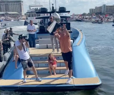 Tom Brady throwing the Lombardi Trophy during the Super Bowl boat parade in Tampa on February 10, 2021
